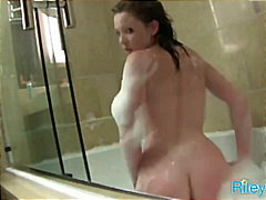 Riley teasing in the bathtub