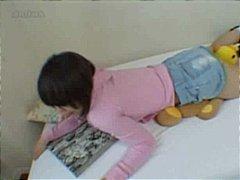 Asian girl fucks her teddy bear to orgasm