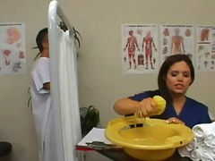 Sweet brunette nurse washes a patient