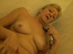 Granny showers and plays with her pussy