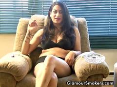 Brunette slut smoking while being interviewed wearing only her undies