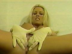 Hot young blonde with great tits loves to finger her pussy with a white glove on