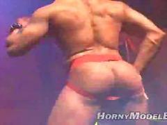 Beefy ebony stripper in night club